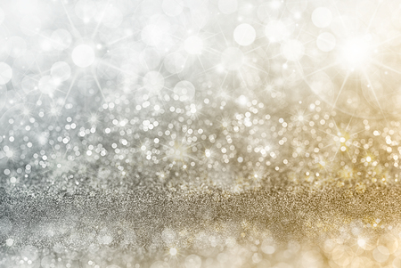 Silver and gold Christmas background with graduated bands of different sparkling and twinkling bokeh from party lights and glitter, full frame copyspace Archivio Fotografico