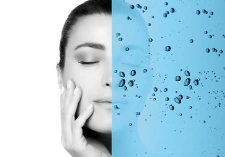 Beauty concept with hydrating water overlay over the face of a gorgeous young woman conceptual of a moisturising skincare treatment at a spa for healthy skin in greyscale and blue with copy space