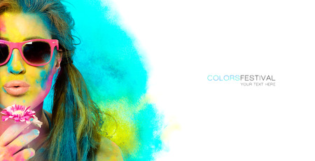 Beautiful sensual woman covered in rainbow colored powder used to celebrate the colors festival wearing colorful sunglasses