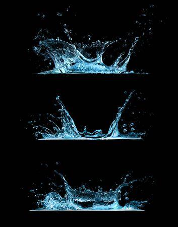 Set of three water splashes isolated on black background