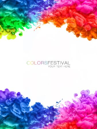 Colors festival. Acrylic ink in water. Multicolored explosions of swirling rainbow ink bordering white background. Includes copy space in center.