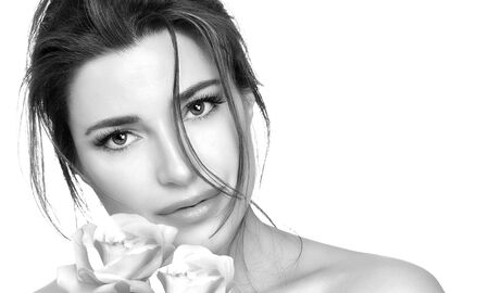 Monochrome close up of a woman beautiful face with white flowers isolated on white background