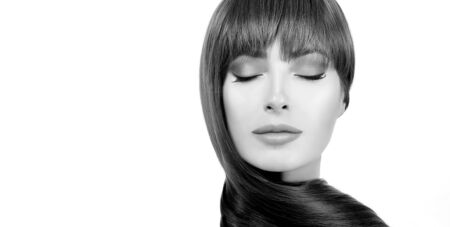 Greyscale hair care banner with a beautiful woman with a healthy straight long hair wound around her neck Stock fotó