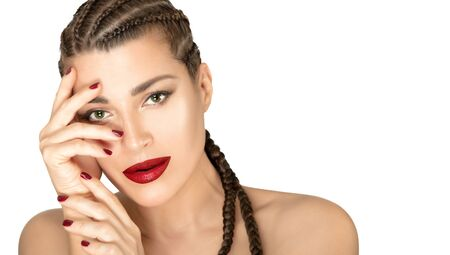 Beauty face young woman with braided healthy hair and bright makeup. Beautiful model with boxer braids, red lipstick and nails. Close up portrait isolated on white background with copy space Zdjęcie Seryjne