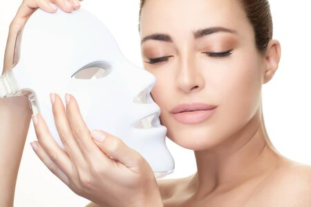 Beauty model woman with led mask.