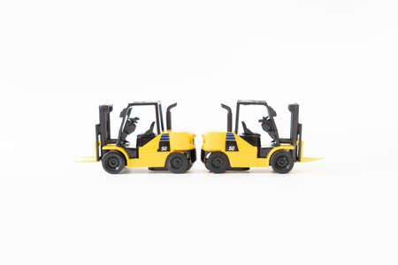 Two Diesel forklift on white background
