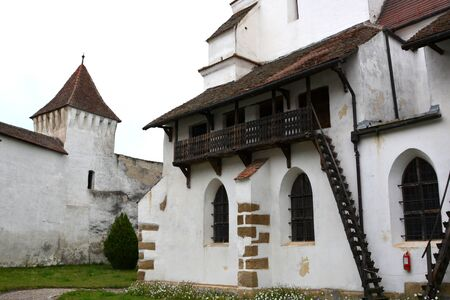 inhabitants: Courtyard of the fortified church Harman (Honigburg), Transylvania Stock Photo