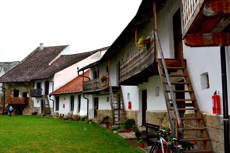 cetatuia: Courtyard of the fortified church in Harman (Honigberg), Transylvania Stock Photo