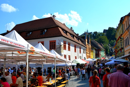 sunday market: Market Square. Urban landscape in the downtown of the medieval Sighisoara, Transylvania.