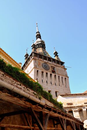 Tower of the old fortress. Urban landscape in the downtown of the medieval Sighisoara, Transylvania.