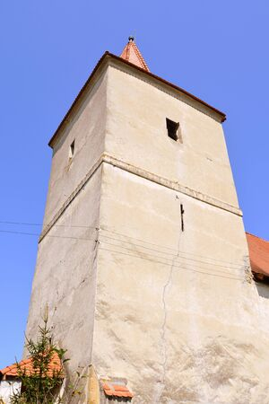 Tower of the Medieval fortified church in Avrig, Sibiu, Transylvania. Evangelical Church is a collection of historical monuments located in the city , centuries XI - XVI. Banco de Imagens