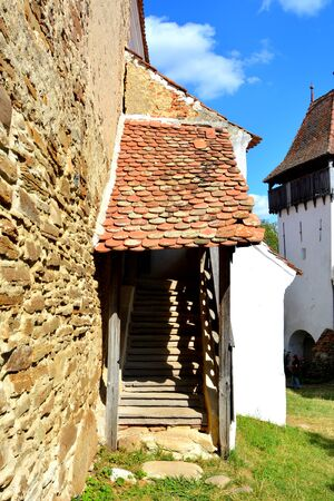 the courtyard: Courtyard of the fortified medieval church in the village Viscri, Transylvania. Stock Photo