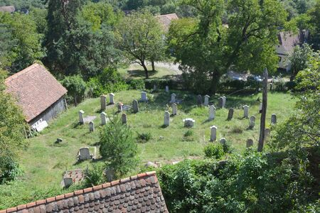 bought: Cemetery of the fortified medieval church in the village Viscri, Transylvania. In 2006, The Prince of Wales bought and restored two 18th century Saxon houses in the Transylvanian villages of M?l�ncrav and Viscri to help protect the unique way of life that