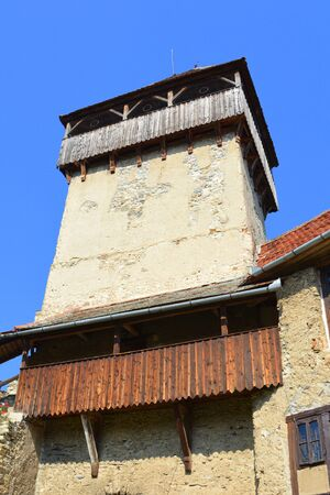 suggestive: Tower of the medieval fortified saxon church in Calnic, Transylvania. Stock Photo
