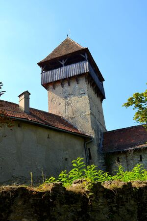 Tower of the medieval fortified saxon church in Calnic, Transylvania. Banco de Imagens