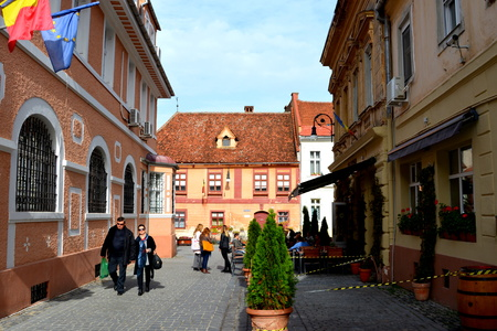 inhabitants: Typical urban landscape in Brasov, Transylvania. Brasov is a town situated in Transylvania, Romania, in the center of the country. 300.000 inhabitants.