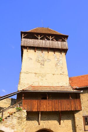 Tower of the medieval fortified saxon church in Calnic, Transylvania. C������¢lnic village is known for its castle, which is on UNESCO`s list of World Heritage Sites. C������¢lnic Citadel, first mentioned in 1269, is very well pr