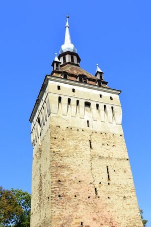 main entrance: Tower. Medieval fortified saxon church Saschiz Keisd, Transylvania. The fortified church is a church in Keisd Wurmloch in the Transylvania region of Romania. Stock Photo