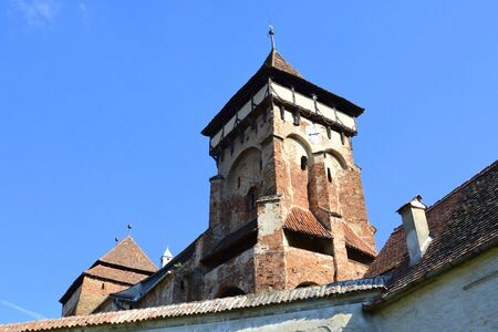 Fortified medieval church in Vineyard Valley, Transylvania Valea Viilor fortified church is a Lutheran fortified church in Valea Viilor (Wurmloch), Sibiu County, in the Transylvania region of Romania. Stock Photo
