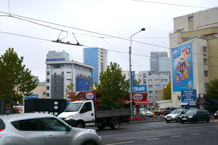 inhabitants: Typical urban landscape in the centre of Bucharest-Bucuresti. Bucharest is the capital of Romania. Bucharest have 3 millions inhabitants and many historical vestiges. Editorial