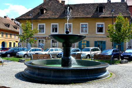 Fountain in the street. Typical urban landscape in the city Sibiu, Transylvania. Sibiu is one of the most important cultural centres of Romania and was designated the European Capital of Culture for the year 2007, along with the city of Luxembourg. Editorial
