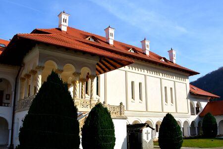 cell tower: Monastery Sambata in Fagaras county, Transylvania. Stock Photo