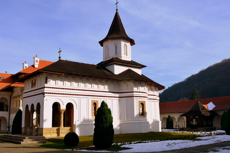 the courtyard: Church inside courtyard. Monastery Sambata is a Romanian Orthodox monastery in Sambata de Sus, Brasov County, in the Transylvania region of Romania. Dedicated to the Dormition of the Mother of God, it is also known as the Brancoveanu Monastery Masnatirea  Stock Photo