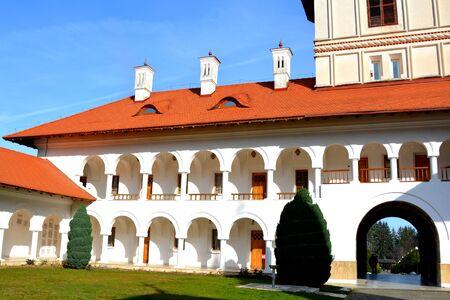 Courtyard. Monastery Sambata is a Romanian Orthodox monastery in Sambata de Sus, Brasov County, in the Transylvania region of Romania. Stock Photo