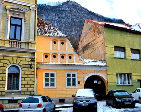 inhabitants: Typical winter urban landscape in the city Brasov, Transylvania. Brasov is a town situated in Transylvania, Romania, in the center of the country. 300.000 inhabitants.