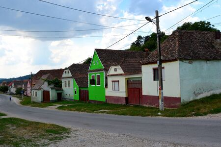 Typical houses. Ungra is a commune in Brasov County, Romania. In Ungra there is a medieval 13th century Transylvanian Saxon church and many old houses.Since its founding it was one of the most important villages in this area, where there was a strong Tran Banco de Imagens