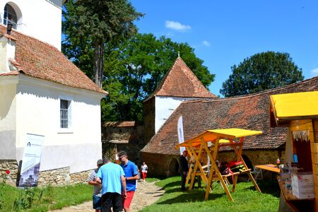 deported: Courtyard of the fortified medieval saxon church Crit. The villagers started building a single-nave Romanesque church, which is uncommon for a Saxon church, in the 13th century. They began construction by building the first choir and a semicircular apse,  Editorial