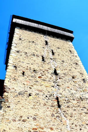 romanesque: Tower of the fortified saxon medieval church Homorod, Transylvania. The villagers started building a single-nave Romanesque church, which is uncommon for a Saxon church, in the 13th century. They began construction by building the first choir and a semici