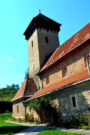 main entrance: Fortified medieval church in the village Malancrav, Transylvania. Here some of the most significant Gothic murals in Transylvania. The Saxon Romanesque Lutheran church has early 14th-century Gothic murals in the apse. 15th-century ones are found in the na