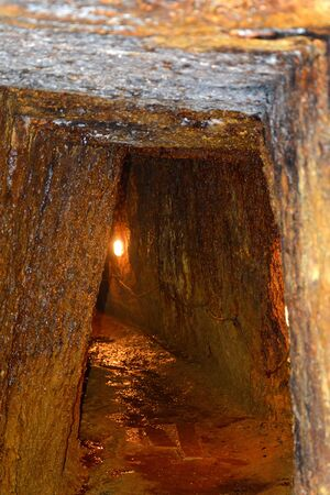 main entrance: Gold - old roman tunnel in gold mine Rosia Montana, Transylvania Rosia Montana is a commune of Alba County in the Apuseni Mountains of western Transylvania, Romania.The rich mineral resources of the area have been exploited since Roman times or before. Stock Photo