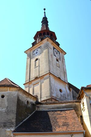 Fortified medieval church in the village Sanpetru, Transylvania.  The landmark of the village is the 13th-century fortified church. The Order of Cistercians received it in 1240. The fortified church was severely destroyed during a Turkish invasion in 1432 Stock Photo