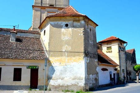 Fortified medieval church in the village Sanpetru, Transylvania.  The landmark of the village is the 13th-century fortified church. The Order of Cistercians received it in 1240. The fortified church was severely destroyed during a Turkish invasion in 1432 Editorial