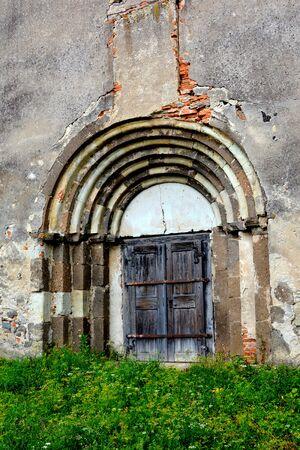 burg: Gate. Courtyard of the medieval saxon fortified church Ungra, Transylvania. Stock Photo