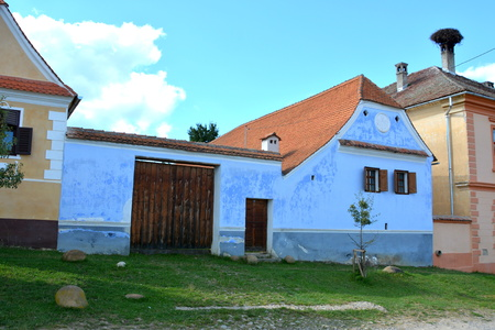recently: Typical houses in the village Viscri, Transylvania. .Viscri is known for his fortified church. The fortified church in this village was built around 1100 AD. It is part of a area if villages with fortified churches in Transylvania, designated in 1993 as a Editorial