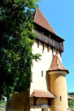mountain pass: Tower. Fortified medieval church Biertan, Transylvania. Biertan is one of the most important Saxon villages with fortified churches in Transylvania. Stock Photo