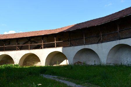 Courtyard. Fortified medieval church in Vineyard Valley, Transylvania Valea Viilor fortified church is a Lutheran fortified church in Valea Viilor (Wurmloch), Sibiu County, in the Transylvania region of Romania. Stock Photo