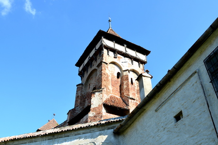Tower. Fortified medieval church in Vineyard Valley, Transylvania Valea Viilor fortified church is a Lutheran fortified church in Valea Viilor (Wurmloch), Sibiu County, in the Transylvania region of Romania. Stock Photo