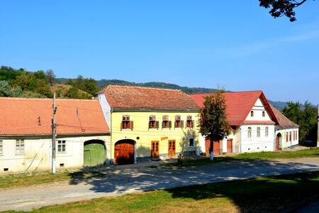burg: Typical houses in the village Saschiz. Medieval fortified saxon church Saschiz Keisd, Transylvania. The fortified church is a church in Keisd Wurmloch in the Transylvania region of Romania. It was built by the ethnic German Transylvanian Saxon community.
