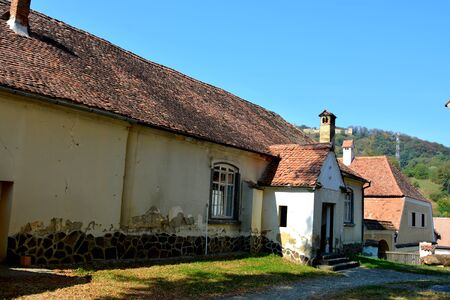 Typical houses in the village Saschiz, in the area of the church. Medieval fortified saxon church Saschiz Keisd, Transylvania. The fortified church is a church in Keisd Wurmloch in the Transylvania region of Romania. It was built by the ethnic German Tran