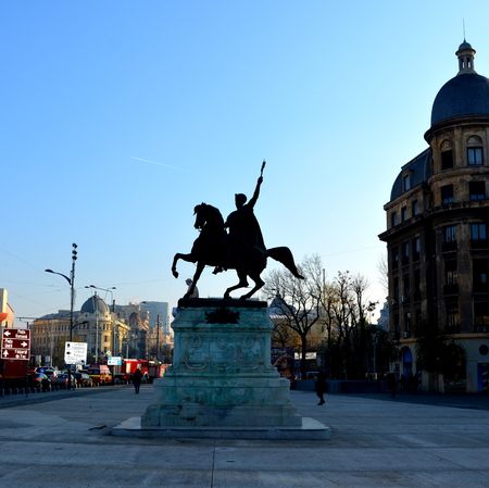 Statue of Michael the Brave. Typical urban landscape in the centre of Bucharest - Bucuresti Bucharest is the capital of Romania. Bucharest have 3 millions inhabitants and many historical vestiges.
