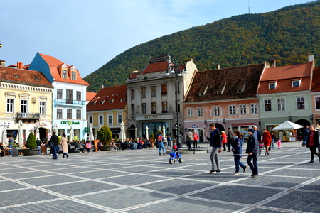inhabitants: Typical urban landscape of the city Brasov, Transylvania Brasov is a town situated in Transylvania, Romania, in the center of the country. 300.000 inhabitants. Editorial