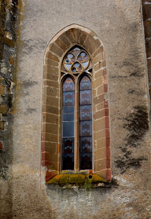 Window in the fortified medieval church Ghimbav, Transylvania The town was first mentioned in a letter written in 1420 by King Sigismund of Luxembourg. The local church and the bell tower were built around 1300. In the 15th century a fortress was built ar Stock Photo