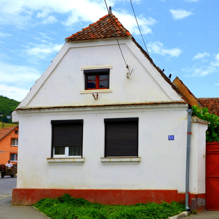 Typical house in the city Codlea.  The fortified church in the city Codlea is the largest in the Burzenland historic region. During the 13th century, the Teutonic Order built a fortress known as Schwarzburg (black castle) near the Magura Codlei. The castl