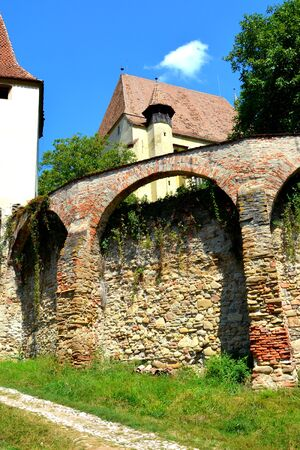 mountain pass: Fortified medieval church Biertan, Transylvania. Biertan is one of the most important Saxon villages with fortified churches in Transylvania, having been on the list of UNESCO World Heritage Sites since 1993. The Biertan fortified church was the see of th Stock Photo