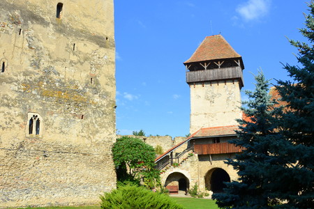 main entrance: Courtyard of the medieval fortified saxon church in Calnic, Transylvania Câlnic village is known for its castle, which is on UNESCOs list of World Heritage Sites. Câlnic Citadel, first mentioned in 1269, is very well preserved. Built as a nobles resid