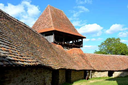 Courtyard. Medieval saxon fortified church Viscri.  Viscri is known for his fortified church. The fortified church in this village was built around 1100 AD. It is part of a area if villages with fortified churches in Transylvania, designated in 1993 as a  Editorial